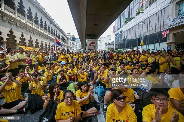 Protesters listen to a speech near the Merdeka Square during a Bersih rally as protestors call for the resignation of Prime Minister Najib Razak on...