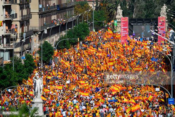 TOPSHOT Protesters listen to Peruvian writer Mario Vargas Llosa during a demonstration called by 'Societat Civil Catalans' to support the unity of...