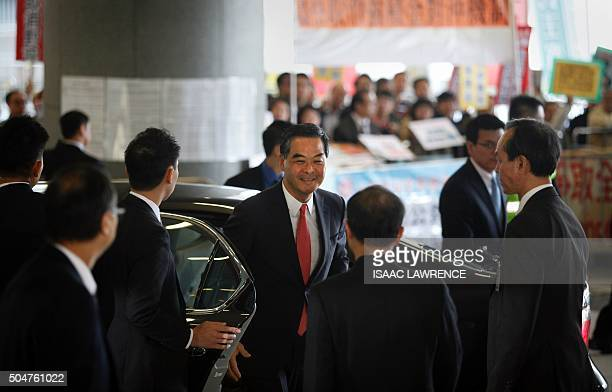 Protesters look on as Hong Kong's Chief Executive Leung Chunying arrives at the Legislative Council to deliver his 2016 Policy Address in Hong Kong...