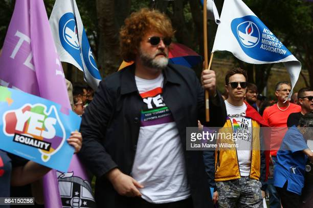 Protesters look on during the YES March for Marriage Equality on October 21 2017 in Sydney Australia Australians are currently taking part in the...