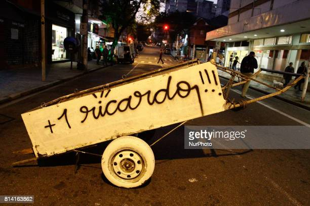 Protesters make an act against the death of paper picker Ricardo Silva Nascimento in Sao Paulo Brazil on 13 July 2017 The cartwright who lived in...