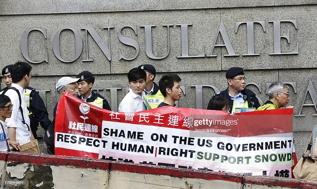 Protesters make their way past the main entrance of the US Consulate in Hong Kong in support of Edward Snowden on June 15 2013 in Hong Kong Hong Kong...