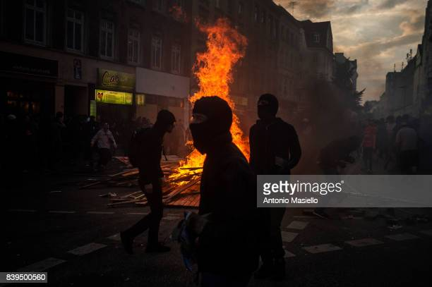 Protesters making a fire road blocks in the St Pauli zone during riots on July 8 2017 in Hamburg northern Germany German police and protesters...