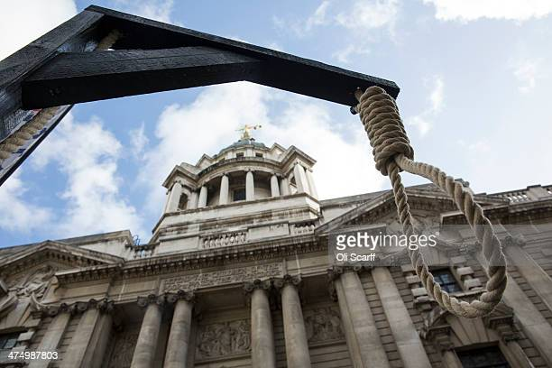 Protesters many from farright political organisations erect a gallows as they demonstrate outside the Old Bailey before the sentencing of Michael...