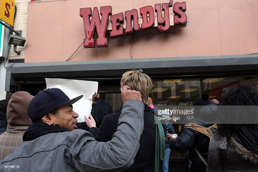 Protesters, many of them employees at Wendy's fast-food restaurant, demonstrate outside of one of the restaurants to demand higher pay and the right to form a union on November 29, 2012 in New York City. The campaign, called 'Fast Food Forward,' organized protests at other New York fast-food establishments including McDonald's, Burger King, KFC, Pizza Hut, Taco Bell and Domino's. The group seeks to double hourly pay to $15 an hour .