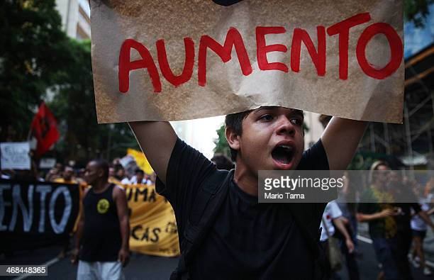 Protesters march against the new increase in public bus fares on February 10 2014 in Rio de Janeiro Brazil Widespread protests began in the country...