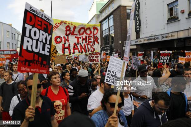 Protesters march along Notting Hill Gate after a gathering at Kensington Town Hall back to Grenfell Tower on June 16 as they demand justice for those...