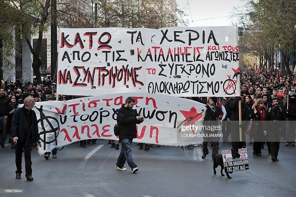 Protesters march behind a banner reading 'hands off the squats' in Athens on January 12, 2013. Several thousand people demonstrated in Athens to protest recent police operations against squatters in public buildings that have been condemned by the opposition. The protesters -- estimated by police at around 3,500 and nearly double that by media -- marched to the Athens court complex and police headquarters to demand the release of scores of individuals arrested in the sweeps. One of the central Athens buildings, a 19th-century former school, had been occupied for over two decades. The other is a stately block of flats whose former occupants include legendary soprano Maria Callas before her rise to fame.