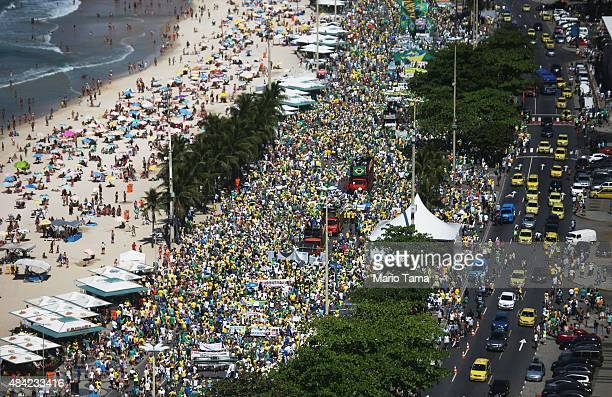 Protesters march calling for the impeachment of President Dilma Rousseff along Copacabana beach on August 16 2015 in Rio de Janeiro Brazil A massive...