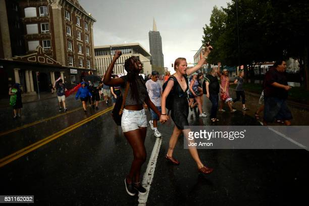 Protesters march down Colfax during a Peace March from the Martin Luther King Statue in Denver's City Park to the Denver Capitol in a pouring rain...