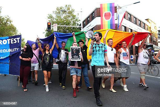 Protesters march down Oxford St during a rally against alleged police brutality at the annual Sydney Gay and Lesbian Mardi Gras parade on March 8...