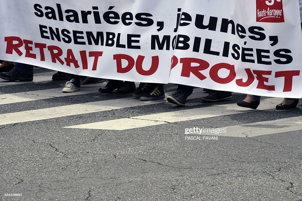 Protesters march during a demonstration against proposed government labour and employment law reforms on May 26, 2016 in Toulouse. Workers at nuclear power stations in France were set to go on strike May 26, joining a growing protest movement against controversial labour market reforms that has already severely disrupted fuel supplies. Unions have called for fresh rallies in cities across France on May 26, the latest bout of social unrest that started around three months ago and has frequently turned violent. PAVANI