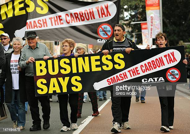 Protesters march during a no carbon tax rally in Sydney on July 1 2012 Australia on July 1 introduced a controversial carbon tax in a bid to tackle...