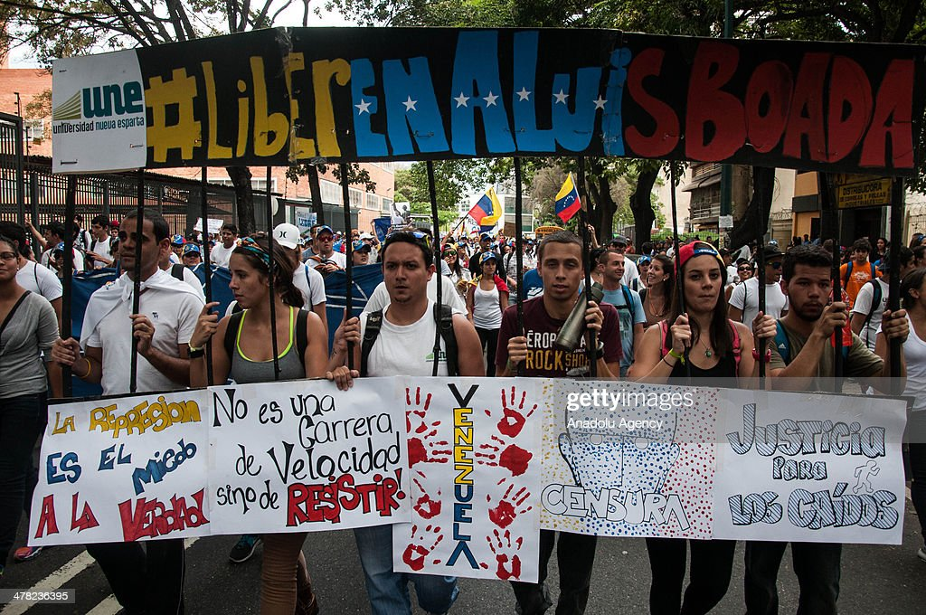 Protesters march during an anti-government protest in Caracas, Venezuela on March 12, 2014. Three people including a university student and a National Guard member, were shot death and several others injured on Wednesday during the anti-government protests in Venezuela.