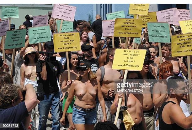 Protesters march during 'National Go Topless Day' to honor Women's Equality Day at Venice Beach in Los Angeles on August 23 2009 The annual protest...