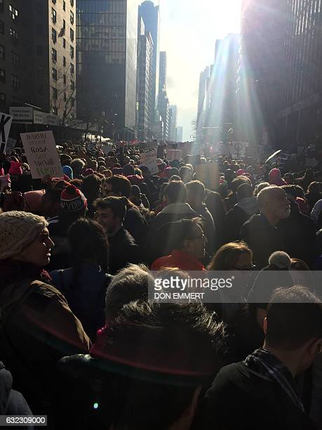 Protesters march during the women's March in New York on January 2017 Tens of thousands of people took to the streets of London Paris and other...