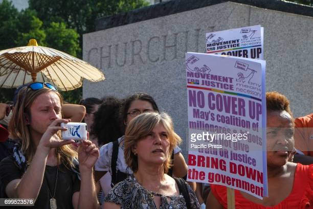 Protesters march from Shepherds Bush to Parliament demanding justice for the victims of the Grenfell Tower fire and Theresa Mays resignation The...