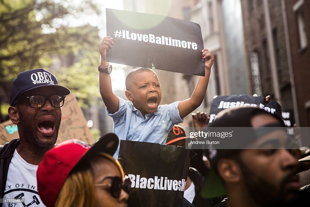 Protesters march from the Sandtown neighborhood to City Hall demanding better police accountability and racial equality following the death of Freddie Gray on April 30, 2015 in Baltimore, Maryland. Gray, 25, was arrested for possessing a switch blade knife April 12 outside the Gilmor Houses housing project on Baltimore's west side. According to his attorney, Gray died a week later in the hospital from a severe spinal cord injury he received while in police custody.