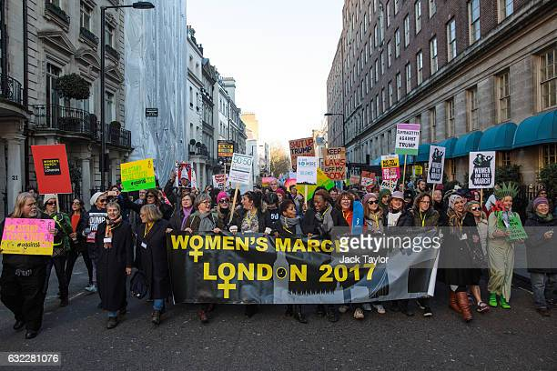 Protesters march from The US Embassy in Grosvenor Square towards Trafalgar Square during the Women's March on January 21 2017 in London England The...