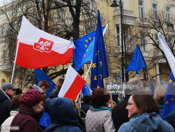 Protesters march in a protest in support of the European Union on March 25 2017 in Warsaw Poland The slogan of the protest 'I love you Europe' was...