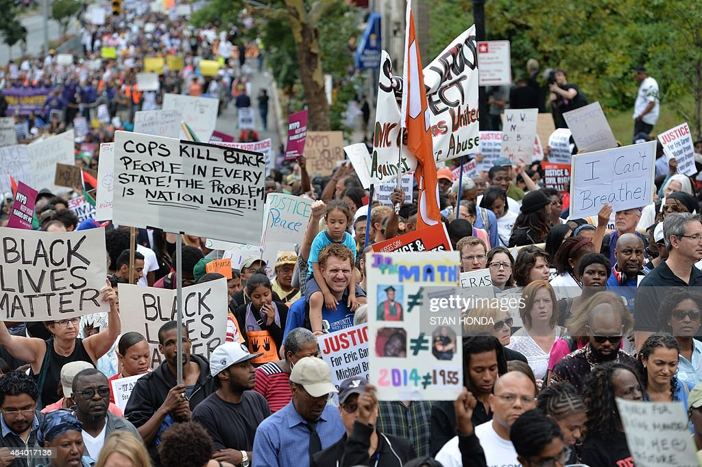 Protesters march in a rally against police brutality in memory of Eric Garner August 23 2014 in Staten Island New York The New York City medical...