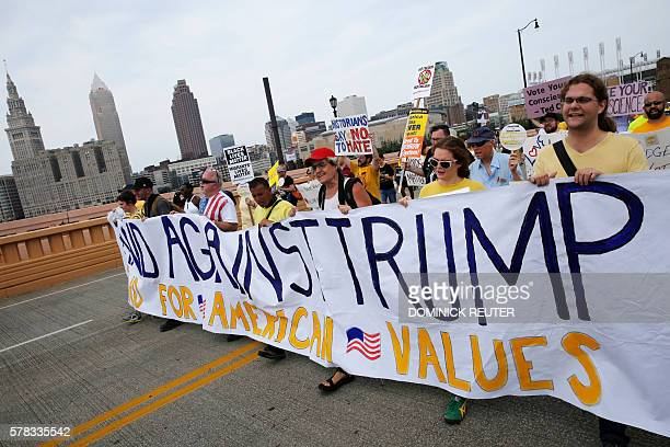 Protesters march in a rally against Republican presidential nominee Donald Trump on the final day of the Republican National Convention on July 21 in...