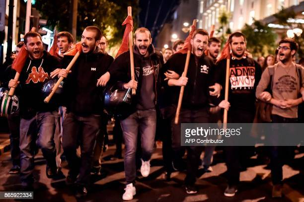 Protesters march in central Athens on October 24 2017 against the 'suppression of the state' following the decision of the Court of Appeal to reject...