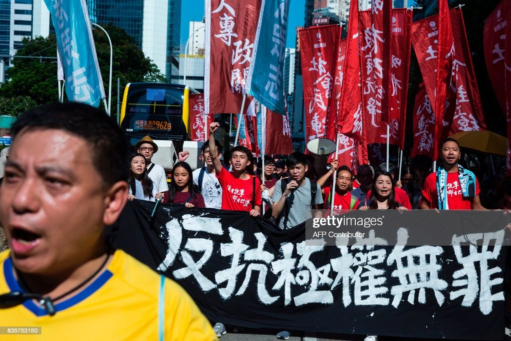 Protesters march in Hong Kong on August 20, 2017, to protest the jailing of Joshua Wong, Nathan Law and Alex Chow (not pictured), the leaders of Hong Kong's 'Umbrella Movement', after their sentencing at the High Court on August 17. Wong, Law and Chow were handed sentences of six to eight months by the Court of Appeal for their role in 2014's massive Umbrella Movement protests, which called for fully free leadership elections and were an unprecedented challenge to Beijing. /