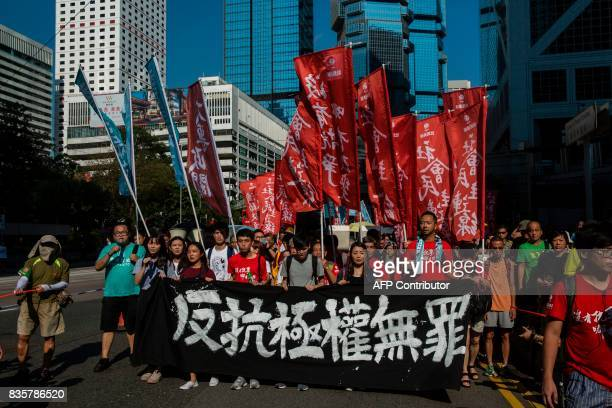 Protesters march in Hong Kong on August 20 to protest the jailing of Joshua Wong Nathan Law and Alex Chow the leaders of Hong Kong's 'Umbrella...