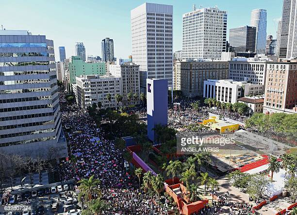 Protesters march in Los Angeles during the Women's March on January 21 2017 Tens of thousands of people took to the streets of London Paris and other...