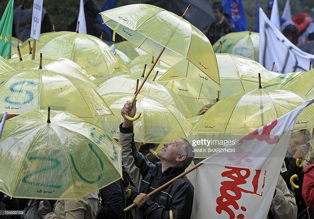 Protesters march in solidarity with trade unions during a demonstration against budget cuts in front of the Polish government office in Warsaw on...