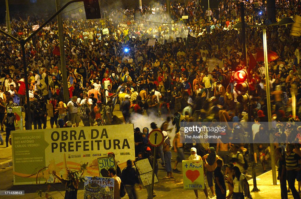Protesters march on at one kilometers check point from Estadio Mineirao, on June 22, 2013 in Belo Horizonte, Brazil. 60,000 protesters gather and 12 injured.