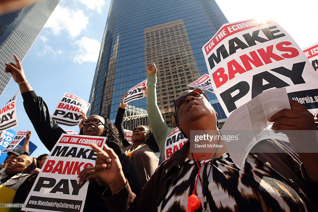 Protesters march on downtown banks on October 6 2011 in Los Angeles California The demonstrators are marching to major bank offices to protest the...