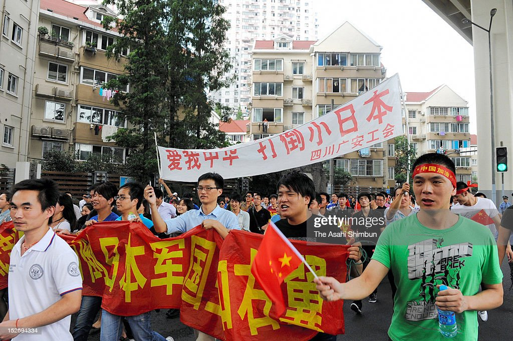 Protesters march on during an anti Japan rally on September 18, 2012 in Shanghai, China. There were protests in many major cities in China, including Shanghai, Shenzhen, Shenyang, Hangzhou, Harbin, Qingdao and Hong Kong as they oppose to the Japanese government's purchase of the disputed Senkaku/Diaoyu islands.