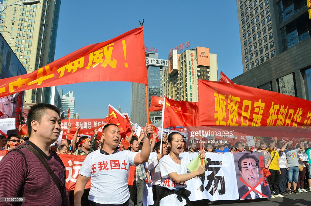 Protesters march on during an anti-Japan rally on September 15, 2012 in Changsha, China. There were protests in many major cities in China, including Shanghai, Shenzhen, Shenyang, Hangzhou, Harbin, Qingdao and Hong Kong as they protest to the Japanese government's purchase of the disputed Senkaku/Diaoyu islands.