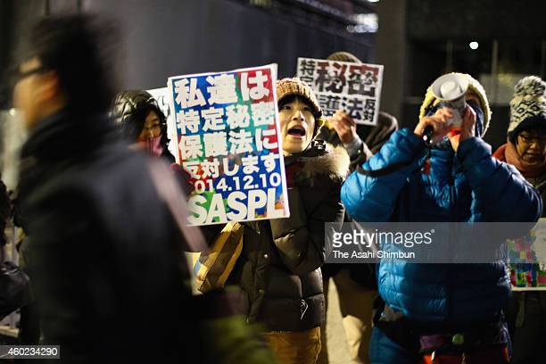 Protesters march on in front of Prime Minister Shinzo Abe's official residence a day before the state secret protection law coming into force on...