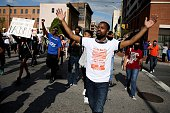 Protesters march on the street from City Hall a day after Baltimore authorities released a report on the death of Freddie Gray May 2 2015 in...