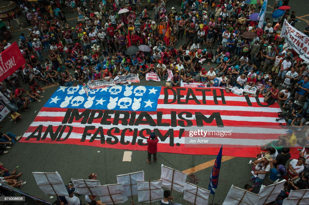 Protesters march on the streets and carry a US flag to burn as protest to US President Trump's visit in the Philippines on November 14, 2017 in Manila, Philippines. Hundreds of Filipinos protested in Manila as U.S. President Donald Trump attended the Association of Southeast Asian Nations (ASEAN) Summit in the Philippines, marking the last leg of his 12-day Asia trip.