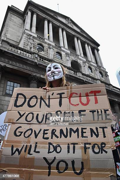 Protesters march outside the Bank of England during a demonstration against austerity and spending cuts on June 20 2015 in London England Thousands...