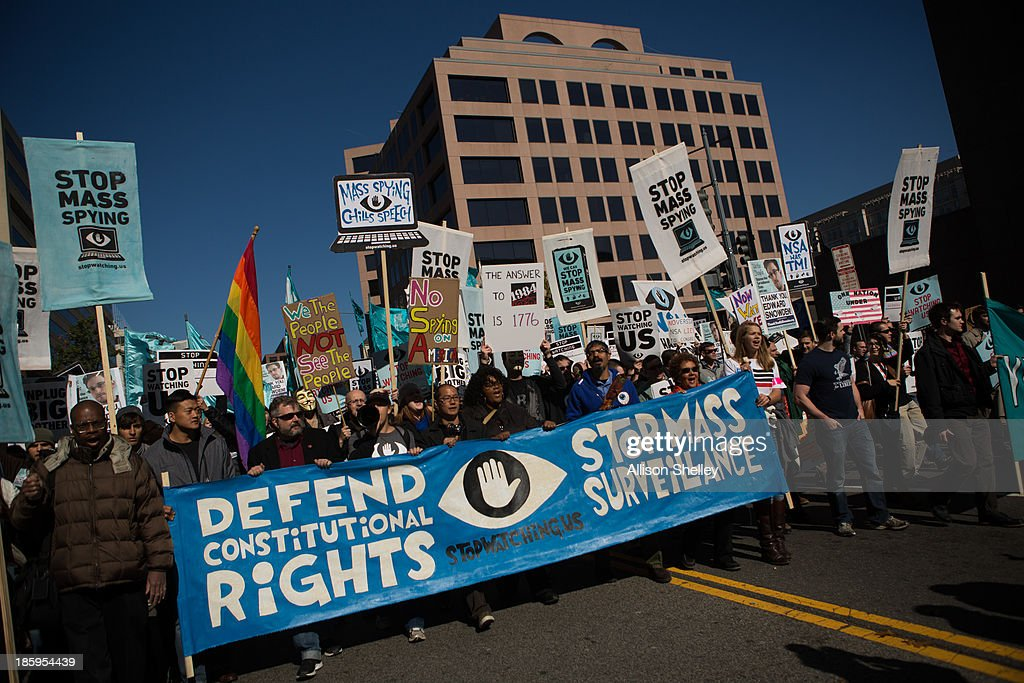Protesters march through downtown Washington DC during the Stop Watching Us Rally protesting surveillance by the US National Security Agency on...