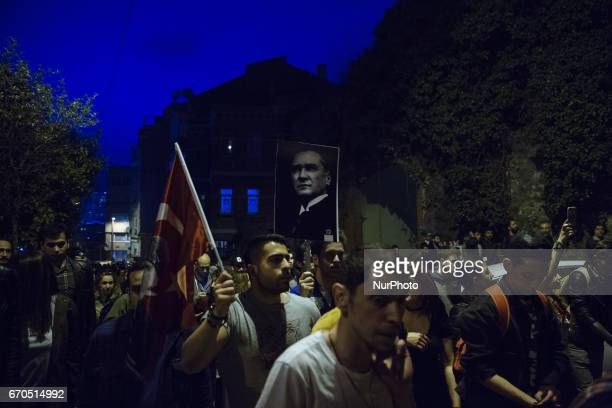 Protesters march through the Besiktas neighborhood of Istanbul on April 19 2017 People marched in opposition to perceived voting irregularities in...