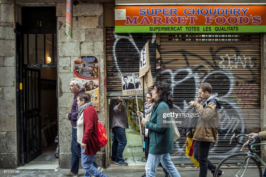 Protesters march through the Raval neighbourhood during a regional strike called by pro-independence union in Barcelona, Spain, on Wednesday, Nov. 8, 2017. Spanish Prime MinisterMariano Rajoyinvoked extraordinary powers last month to reassert his authority over Catalonia and fire Catalan presidentCarles Puigdemont and his government.Photographer: Angel Garcia/Bloomberg via Getty Images