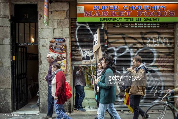 Protesters march through the Raval neighbourhood during a regional strike called by proindependence union in Barcelona Spain on Wednesday Nov 8 2017...