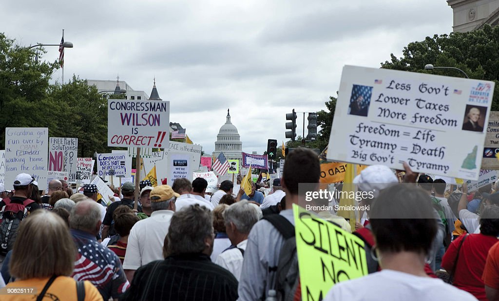 Protesters march to Capitol Hill during the Tea Party Express rally on September 12 2009 in Washington DC Thousands of protesters gathered in...