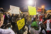 Protesters march to the convenience store where Alton Sterling was shot and killed July 6 2016 in Baton Rouge Louisiana Sterling was shot by a police...