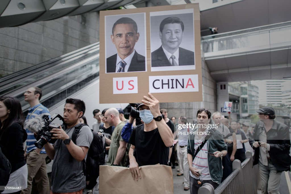 Protesters march to the US consulate in support of Edward Snowden from the US in Hong Kong on June 15, 2013. Snowden, a former CIA technical assistant, is in hiding in Hong Kong after he arrived in the city on May 20 and blew the lid on a vast electronic surveillance operation by the National Security Agency, which has hit targets in China and Hong Kong. AFP PHOTO / Philippe Lopez