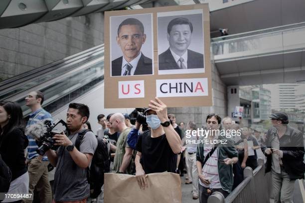 Protesters march to the US consulate in support of Edward Snowden from the US in Hong Kong on June 15 2013 Snowden a former CIA technical assistant...