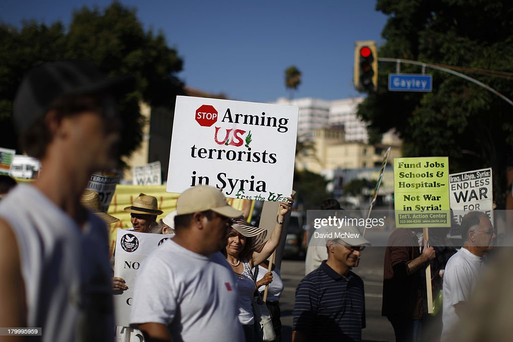 Protesters march to urge Congress to vote against a limited military strike against the Syrian military in response to allegations that President Bashar Hafez al-Assad has used sarin gas to kill civilians on September 7, 2013 in Los Angeles, California. The Obama administration claims to have clear evidence that the Syrian military broke international law by killing nearly 1,500 Syrian civilians, including at least 426 children, in a chemical weapons attack on August 21, and is seeking the support of Congress for a missile strikes to prevent future chemical weapons attacks by the regime and other nations.