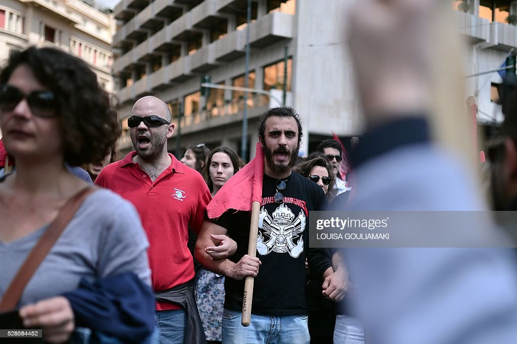 Protesters march toward the Greek parliament in Athens , during a demonstration marking a 48-hour general strike, on May 6, 2016. Greece's labour unions stage a two-day general strike to protest controversial government plans to overhaul pensions and increase taxes to meet demands of its bailout creditors . / AFP / LOUISA