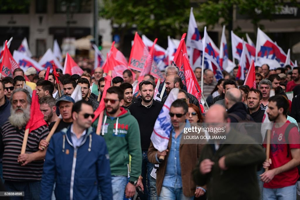 Protesters march toward the Greek parliament in Athens, during a demonstration marking a 48-hour general strike, on May 6, 2016. Greece's labour unions stage a two-day general strike to protest controversial government plans to overhaul pensions and increase taxes to meet demands of its bailout creditors . / AFP / LOUISA